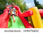 Small Boy Jumping Down The...