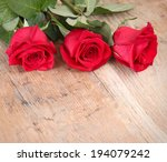 red roses on a wooden background | Shutterstock . vector #194079242
