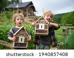 Small boy and girl holding bug...
