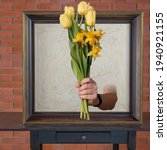 Hand Holds Out Flowers From The ...