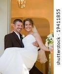 groom carrying bride into home | Shutterstock . vector #19411855
