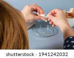 Women Hands Removing Eggshell...