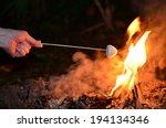 woman hand roast marshmallow on ... | Shutterstock . vector #194134346