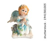 Small photo of angel statue isolated on white background. Figurine of an angel on a white background. Ceramic angel isolated.