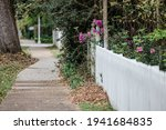 A White Picket Fence With...