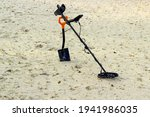 Metal Detector And Shovel In...