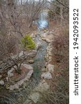 Small photo of Small creek contained by landscaping rock, slowly feeding into Lake Shawnee, outside of Topeka. Popular travel destination that features a wide variety of outdoor areas and scenes.