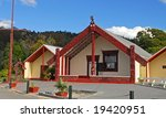 New Zealand carved maori marae (meeting house and meeting ground) - stock photo