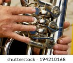 fragment of tuba with hands of... | Shutterstock . vector #194210168