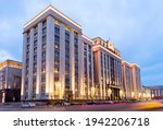 Small photo of Moscow, Russia - March 22, 2021: Building of the State Duma of the Russian Federation. The monumental building was built in 1932-1935. The light gray facade of an absolutely symmetrical building.