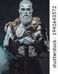 Small photo of Nordic warlike undead with hatchet in smokey background
