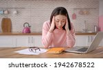 Small photo of Bored sleepy asian lady sitting at desk with laptop, holding head, resting on hand, sleeping at workplace, tired young female feeling drowsy, lazy and unmotivated student, boring job, lack of sleep