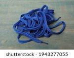 Shoelaces On Light Blue Wooden...
