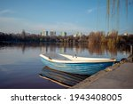 Small Rowboat Anchored By The...