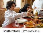 Arabian Family Having Dinner ...