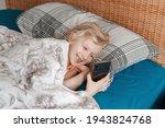 Cute Girl Lying In Bed In...