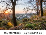 Nove Mesto nad Metuji, amazing small city in eastern Bohemia. Colorful evening view at sunset with sunrays in trees, view from Jurankova lookout at Vyrov ruin castle, Czech Republic
