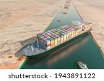 Maritime traffic jam. Container cargo ship run aground and stuck in Suez Canal, blocking world