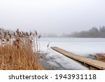 Wooden Footbridge On Lake With...