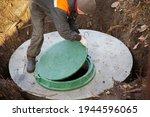 A Worker Installs A Sewer...