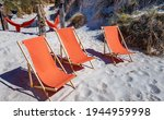 Three Orange Color Deck Chairs...