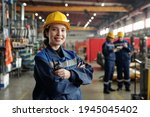 Young Smiling Female Worker Of...