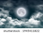 Moon In Night Sky With Clouds...