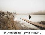 Traveller Standing On A Bridge...