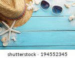 beach accessories on wooden... | Shutterstock . vector #194552345