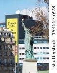 Small photo of Paris, France - 03.04.2016: View from Quai de Grenelle Quay to Statue of Liberty Paris and Maison de la Radio France House