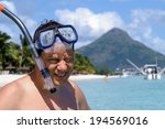 man with mask and snorkel is... | Shutterstock . vector #194569016