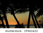 Sunset featuring palm and ocean in Rarotonga, Cook Islands - stock photo