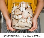 Female Hands Holding A Jar With ...