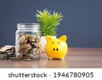 Coins In A Glass Jar With Pig...