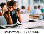 young businesswoman talking on... | Shutterstock . vector #194704832