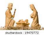 Small photo of Wooden figures of Mary and Joseph watching baby Jesus, isolated on white
