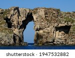 Natural Arch On The Cliffs Of...