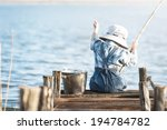 little boy is fishing at sunset ... | Shutterstock . vector #194784782