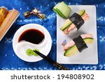 japanese nigiri sushi with salmon and fresh avocado - stock photo