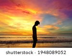 Silhouette of lonely young man...