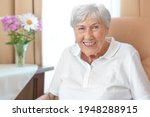 Smiling Senior Woman With An...