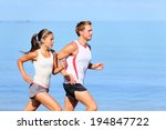 running couple jogging on beach.... | Shutterstock . vector #194847722