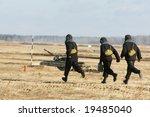 Three Troopers Run To A Tank