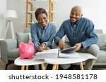 Small photo of Happy African Couple Doing Retire Finances Plan And Money Budget