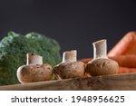 White Mushroom On Wood Cutting...