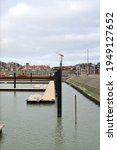 Small photo of Blankenberge, West-Flanders Belgium - April 4, 2021: new floater system, floating platform for boats on the marina docks. View on new marina floating platform