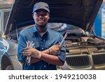 African man mechanic in uniform ...