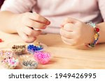The Child Makes Jewelry With...