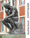 Small photo of NEW YORK CITY, USA - APRIL 2, 2021: Thinker (Le Penseur), bronze sculpture by Auguste Rodin at Columbia University in New York City