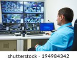 security guard watching video... | Shutterstock . vector #194984342